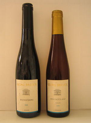 A bottle of Riesling Auslese and a bottle of R...
