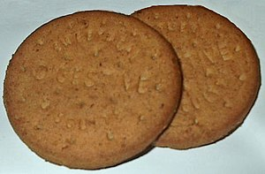 Two Sainsbury's Basics digestive biscuits.