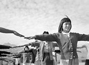 Female prisoners practicing calisthenics