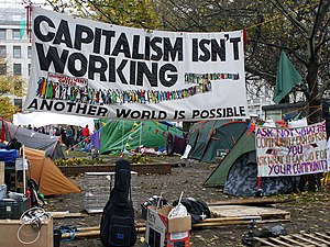 Banners at the moved Occupy London protest in ...