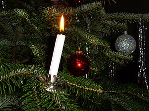 Candle and decoration on a German Christmas tree