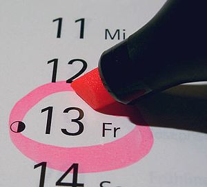 Circling Friday the 13th date on calendar with...