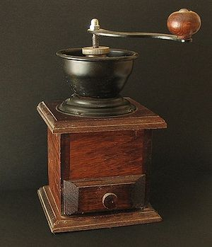 An old-fashioned manual coffee grinder.
