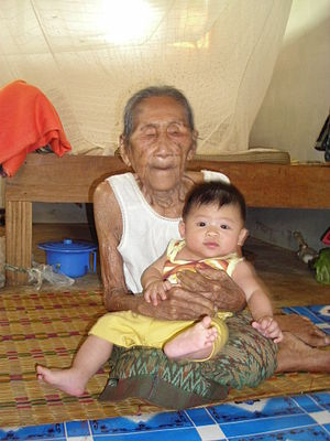 95 y.o. woman holding a 5 month old baby boy (...