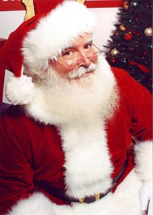 https://i1.wp.com/upload.wikimedia.org/wikipedia/commons/thumb/4/49/Jonathan_G_Meath_portrays_Santa_Claus.jpg/220px-Jonathan_G_Meath_portrays_Santa_Claus.jpg