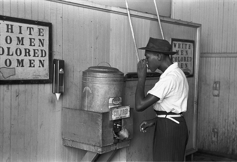 "File:""Colored"" drinking fountain from mid-20th century with african-american drinking.jpg"