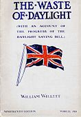 """Pamphlet cover showing a large British flag in red, white, and dark blue, with the large title """"THE WASTE OF DAYLIGHT"""", an unreadable subtitle, and """"WILLIAM WILLETT"""" near the bottom."""