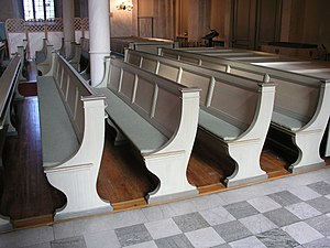 Pews in rows in a church.
