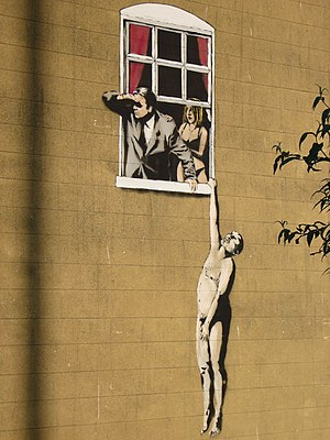 Close up shot of graffitti by Banksy near Park...