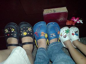Jibbitz shoes on the feet of an adult and two ...