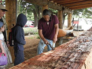 Dugout canoe being carved as a youth project u...