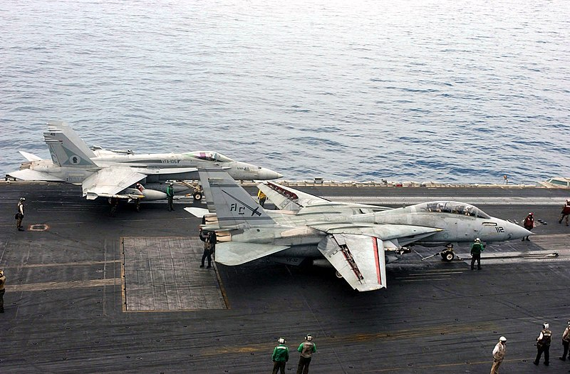 File:US Navy 030408-N-7986B-008 An F-A-18 Hornet (top), assigned to the Gunslingers of Strike Fighter Squadron One Zero Five (VFA-105) and an F-14 Tomcat assigned to the Swordsmen of Fighter Squadron Thirty Two (VF-32) prepare to la.jpg