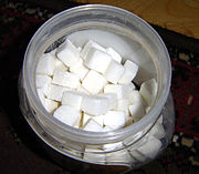 Sugar cubes ready to be added to a cup of tea