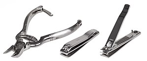 English: A variety of nail clippers, including...