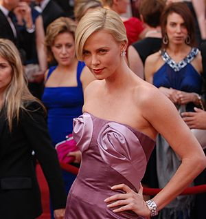 Charlize Theron strikes a red-carpet pose at t...