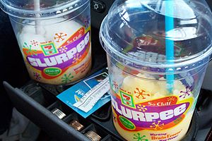 Two Slurpees in a car cupholder.