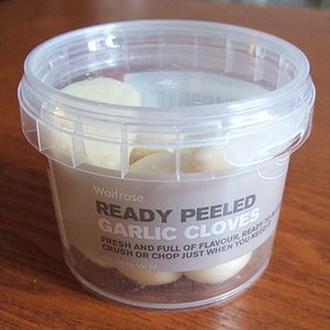 Waitrose ready peeled garlic in a plastic pot.
