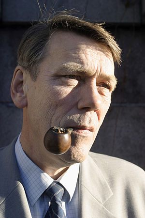 Jóannes Eidesgaard smoking on his pipe.