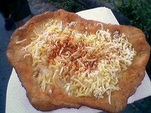 Lángos with cheese and sour cream
