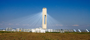 The PS10 solar power tower near Seville concentrates sunlight from a field of heliostats on a central tower.