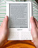 English: Amazon Kindle e-book reader being hel...