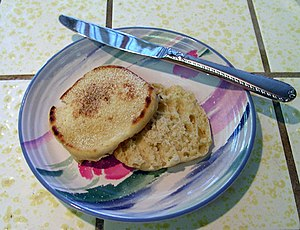 English muffin on a salad plate with table knife.