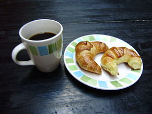 English: Medialunas (croissants) and coffee, b...