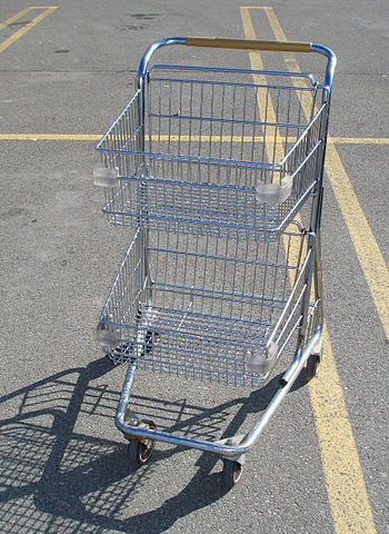 English: Compact shopping cart with 2 baskets,...