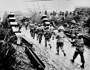 American soldiers cross the Siegfried Line and...