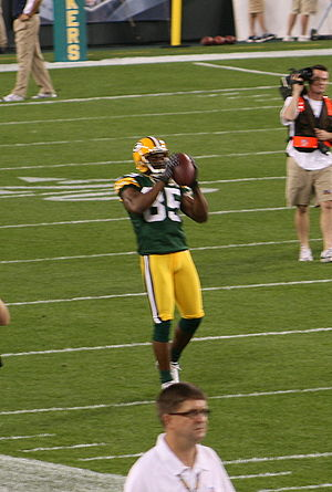 Wide receiver Greg Jennings warming up before ...