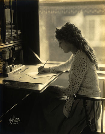 English: Mary Pickford writing at a desk
