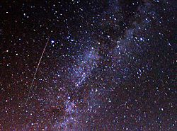 A multicolored, long Perseid crossing the sky (from Wikipedia).