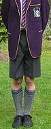 English: A UK scholboy wears a traditional gre...