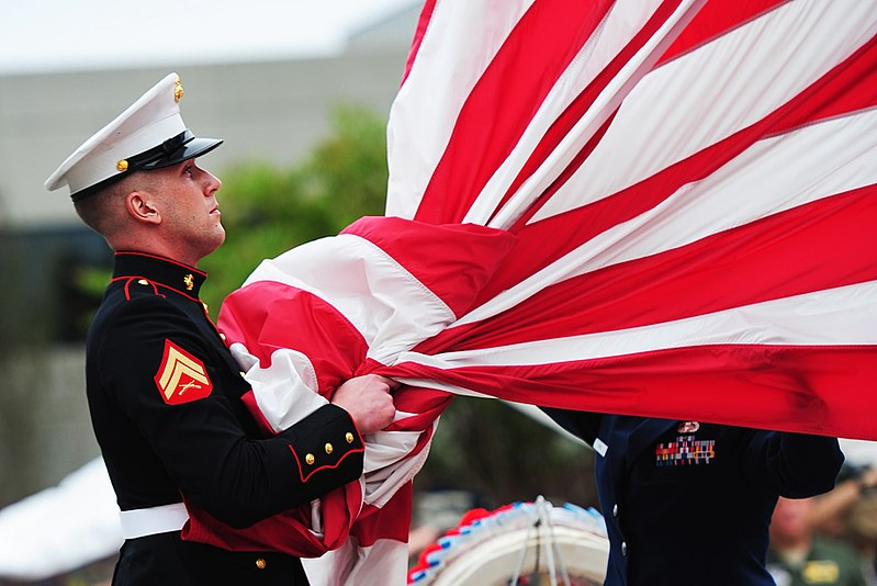 Marine takes the American flag into his hands before folding it with the flag detail at the POW/MIA Remembrance Day retreat ceremony on Sept. 16, 2011, at Joint Base Charleston, S.C