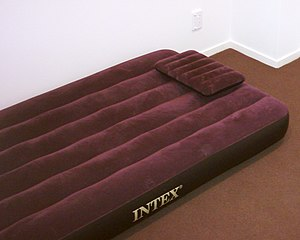 English: An air matress for use as a guest bed.