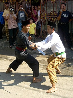 English: Pencak silat Betawi style performed d...