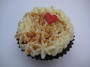 Vegan chocolate stout cupcake topped with orga...