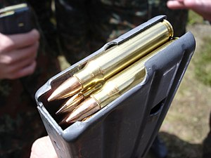 Picture of a 5.56 x 45 mm NATO cartridge in a ...