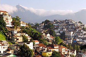 English: Rio de Janeiro slum (right) on hill, ...