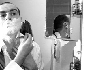 Self-Portrait shaving: mirror reflection