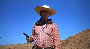 Ethan Edwards (John Wayne) prepares to gun dow...