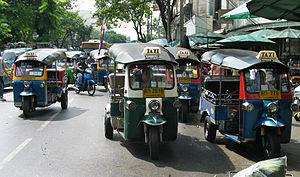 Tuk tuk in front of Pak Klong Market, Bangkok,...