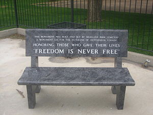 """A park bench with inscription """"Freedom Is..."""