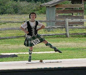 A young Highland dancer demonstrates her form ...
