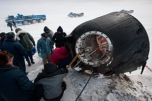 Russian support personnel work to help get cre...