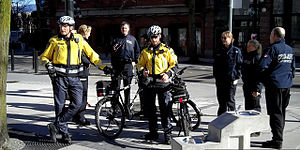 English: RCMP and CBSA officers in Vancouver, ...