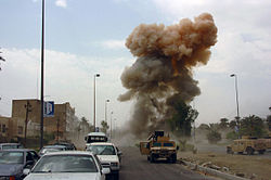 As Coalition Forces respond to a car bombing in South Baghdad, Iraq (IRQ), a second car bomb is detonated, targeting those responding to the initial incident. Date Shot: 14 Apr 2005