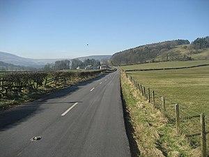 English: Road heading towards Boarsden Portion...