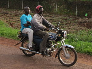 English: Boda-boda. Uganda, somewhere on A109 ...