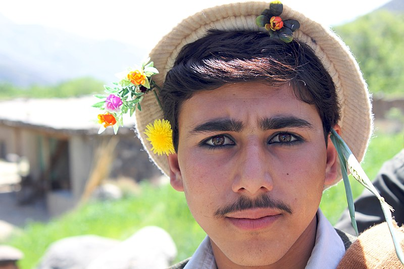File:Young Pashai man with flowers in his hair.jpg